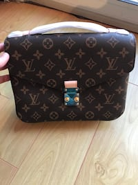 black and gray Louis Vuitton leather crossbody bag