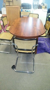 oblong brown wooden trestle table and five brown cantilever chairs dining set High Point, 27262