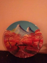 gray and brown mountains painted ceramic plate