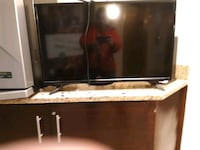 black flat screen TV with remote Germantown, 20876