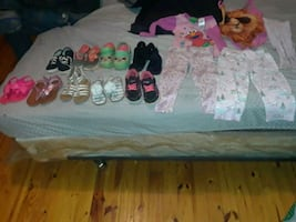 9 pairs of girls size 7 shoes, pants shirt, & swimsuit