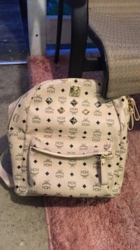 Monogrammed white mcm leather backpack