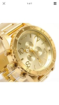 round gold chronograph watch with gold link bracelet Clarksburg, 20871