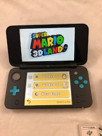 Nintendo 2ds xl with 3 games  503 km