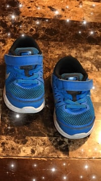 Pair of blue nike running shoes McAllen, 78501