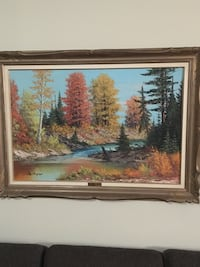 Brown wooden framed painting of forest river