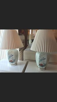two white ceramic base table lamps with pleated lampshades screenshot