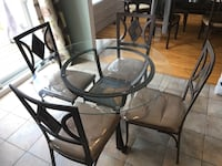 Round glass table with four chairs set Laval, H7N 5T4