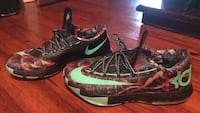 pair of black-and-green Nike basketball shoes 367 mi