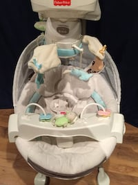 baby's white and blue Fisher-Price bouncer Brampton, L7A 3X7