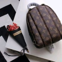 brown Louis Vuitton monogram leather backpack Laval, H7V 3S8