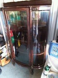 brown wooden framed glass display cabinet Newark