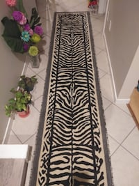 two black-and-green floral area rugs Surrey, V3S 0R6