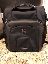 """Tumi Tech backpack Like new!  About 13"""" wide, 14"""" tall. Lots of compartments and padded secure pouch for laptop Leesburg, 20176"""