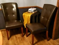 two brown leather padded chairs 468 mi