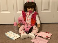 A reborn baby doll with accessories  Douglas, 01516