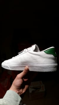 white Nike low-top lace-up shoe