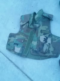 black and gray camouflage tactical vest