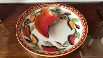 White, red, and green ceramic bowl