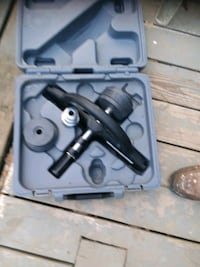 black and gray corded power tool with case 833 mi