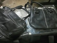 two black leather shoulder bags