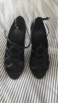 pair of black leather sandals Blainville, J7B 1Z6