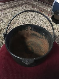 2 quart unmarked cast iron pot with bail type hand forged handle.