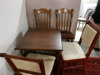 rectangular brown wooden table with four chairs di Mississauga