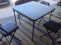 rectangular black metal table with two chairs