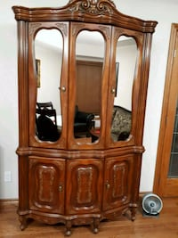 Solid wood carved armoire  Cambridge, N1T 2C6