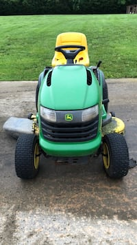 green and black John Deere ride on lawnmower 24 km