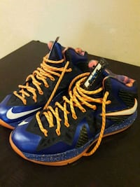 pair of blue-and-yellow Nike basketball shoes Pompano Beach, 33065