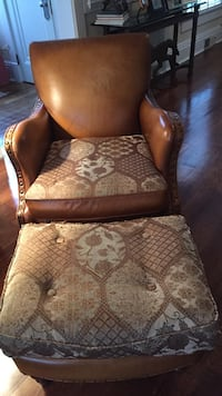 brown and gray leather armchair and ottoman