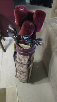 black and red golf bag with golf clubs Rockville