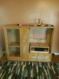 brown wooden TV hutch with flat screen television Rainbow City, 35906