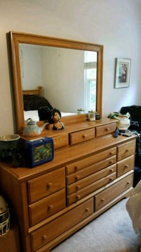 brown wooden dresser with mirror null