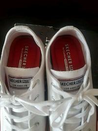 pair of white-and-red Skechers sneakers