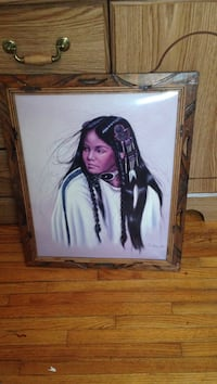 brown wooden framed painting of native american women