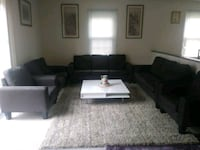 black fabric sectional sofa and throw pillows 25 km
