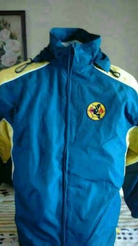 blue and yellow zip-up turtle neck jacket