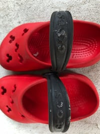 pair of red Crocs rubber clogs