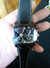 round black chronograph watch with black leather strap Longueuil, J4K 4C1