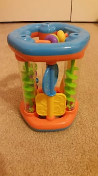 toddler's orange, blue, and green activity toy