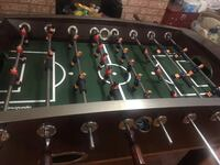 Black and green foosball table 548 km