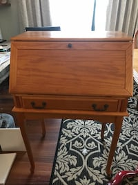 brown wooden pedestal chest