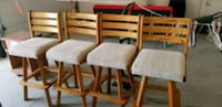 four brown wooden framed white padded chairs Nampa, 83686