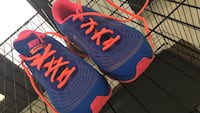 blue-and-pink Nike low-top sneakers