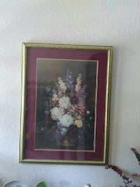 painting of white, pink, and purple flower arrangement in brown bucket with gold-colored frame