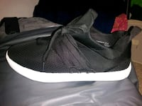 pair of black Nike running shoes Silver Spring