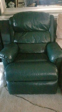 green leather sofa chair with ottoman